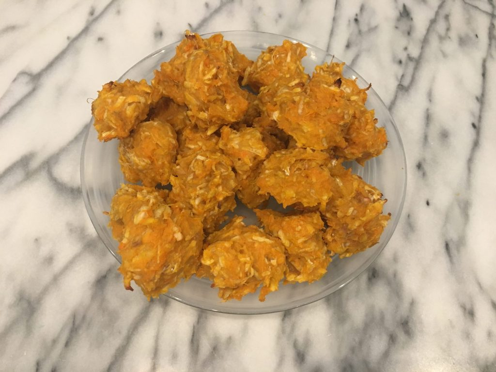 Dairy free toddler finger food of Sweet potato and apple fritters on a marble countertop.