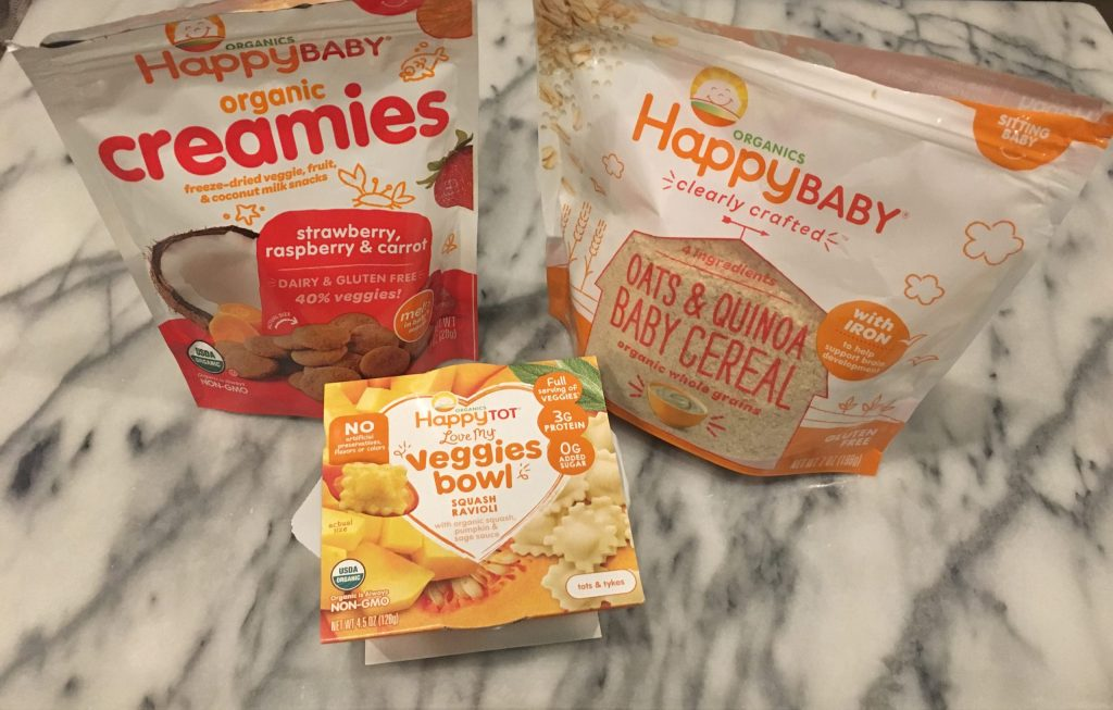 Packages of Happy Baby creamies and oats and quinoa cereal and a Happy Tot Veggie bowl of squash ravioli.  All dairy free!