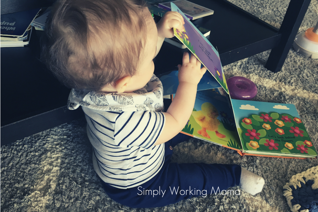 Toddler boy playing with a pop-up book.
