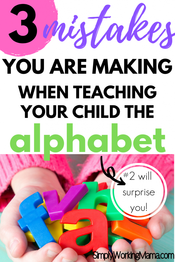 Girl in pink sweater holding colorful magnetic letters; teaching your child the alphabet.