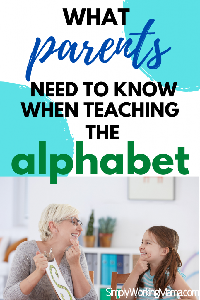 Adult woman working with child to learn the alphabet