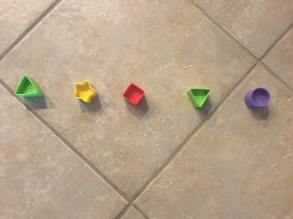 Shapes lined up on the floor to practice phonological awareness.