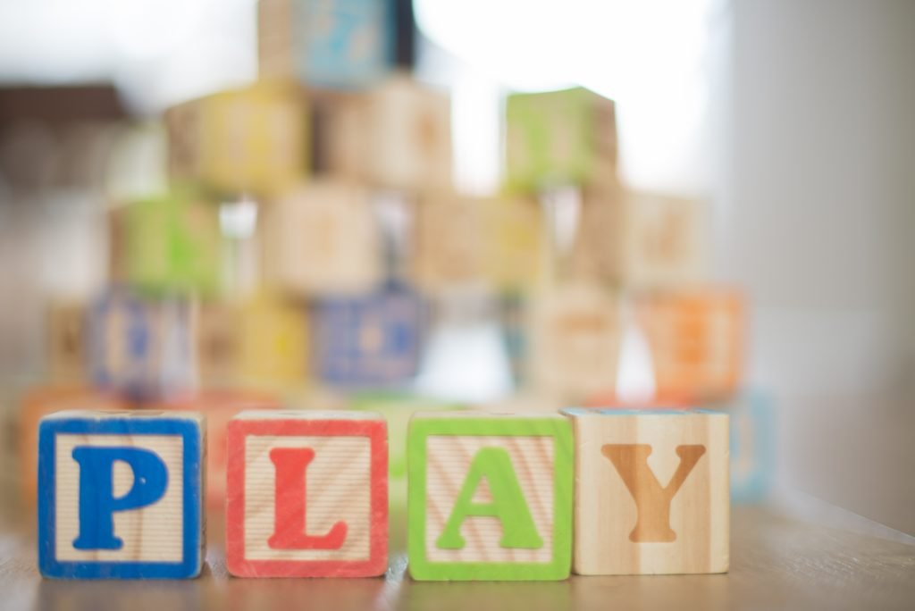 "wooden block letters that spell out ""play"""