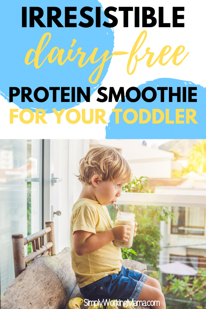 toddler boy outside on a bench drinking a smoothie