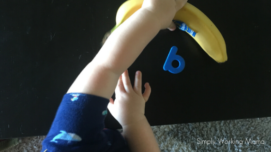 boy grabbing a banana near the letter b; screen-free alphabet activities