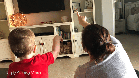 How to teach letters using skywriting; mom and toddler boy skywriting the letter s