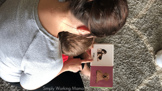 toddler boy reading with mom