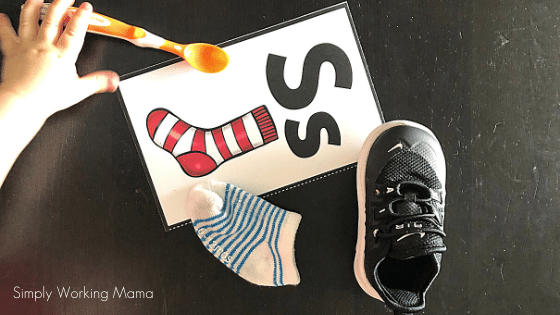 how to teach letters using items from your house; shoe, sock, spoon, and letter keycard for Ss sock.